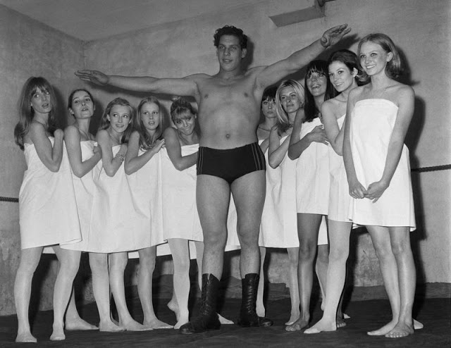 12. This photograph of André surrounded by women in towels was taken in 1966 during a fashion exhibit in Paris.