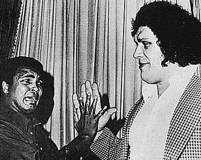 6. André the Giant and Muhammad Ali compare hand sizes upon meeting in 1975.